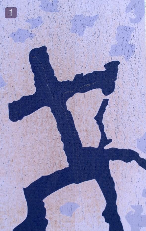 Cruz realizada sobre las antiguas cazoletas aborígenes